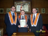 Outoing Worshipful Master Bro William Jamieson being presented with his Past Masters Certificate.
